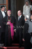 Monsignor Georg Gaenswein ,Pope Benedict XVI receives  Prince Albert II of Monaco and his wife Princess Charlene  at the end of a private audience in his private library at the Vatican on January 12, 2013..