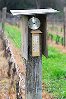 In the vineyard, a weather station with an air pressure meter barometer and a max min thermometer to measure temperature. Bodega Vinos Finos H Stagnari Winery, La Puebla, La Paz, Canelones, Montevideo, Uruguay, South America