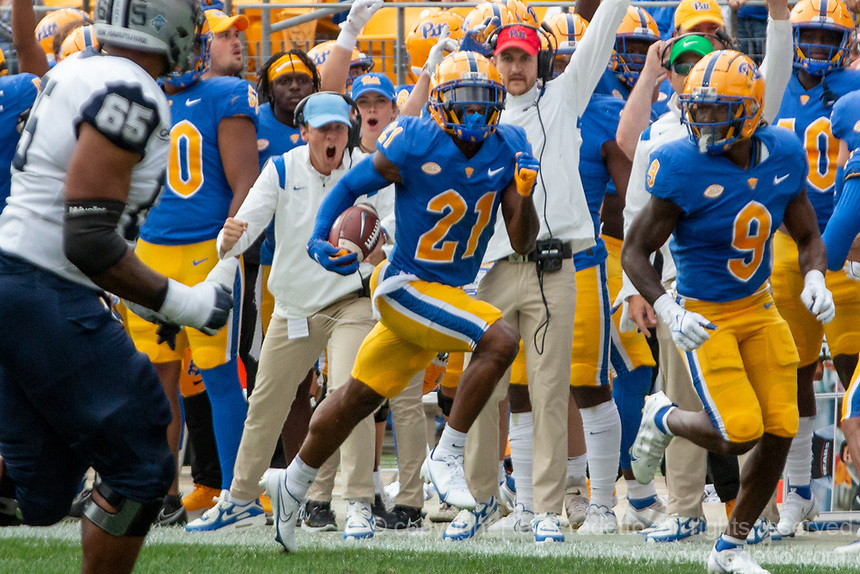 Pitt defensive back Damarri Mathis (21) returns an interception 35 yards for a touchdown. The Pitt Panthers defeated the New Hampshire Wildcats 77-7 at Heinz Field, Pittsburgh, Pennsylvania on September 25, 2021.