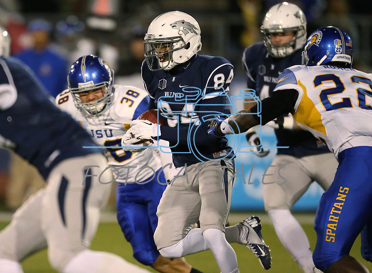 Nevada's Jerico Richardson runs past San Jose State defenders Arthur Gilbreath (38) and Hector Roach (22) in an NCAA college football game in Reno, Nev., on Saturday, Nov. 16, 2013. (AP Photo/Cathleen Allison)