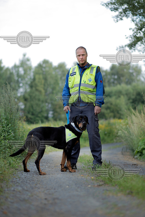 Arve Holm with his dog Sverdrup.<br /> <br /> Rescue workers interviewed following the terror attacks in Norway. ..A large vehicle bomb was detonated near the offices of Norwegian Prime Minister Jens Stoltenberg on 22 July 2011. .Another terrorist attack took place shortly afterwards, where a man killed 68 people, mainly children and youths attending a political camp at Utøya island. ..Anders Behring Breivik was arrested on the island and has admitted to carrying out both attacks..(photo:Fredrik Naumann/Felix Features)