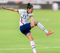 HOUSTON, TX - JUNE 10: Christen Press #23 of the United States watches her shot at the Portugal goal during a game between Portugal and USWNT at BBVA Stadium on June 10, 2021 in Houston, Texas.