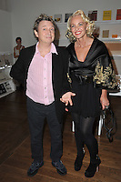 """Amanda Eliasch & Andy Summers of The Police at reception for Amanda Eliasch's neon art exhibition """"Peccadilloes"""" at the Leadapron Gallery, West Hollywood..June 16, 2011  Los Angeles, CA.Picture: Paul Smith / Featureflash"""