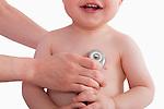 USA, Illinois, Metamora, close-up of smiling baby boy (12-17 months) having medical exam