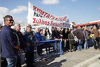 Pictured: A group of local people who happen to be protesting against the closure of the local hospital are protesting in the area and witness the disembarkation of the illegal immigrants to Ierapetra Thursday 27 November 2014<br />