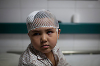 Aliya, a five year old Uighur girl who was beaten on the head when her and her pregnant mother were attacked by a Han Chinese mob on July 6th, recovers in Number 2 Hospital in Urumqi. Ethnic violence between the Uighur and Han Chinese erupted in the city a few days earlier..