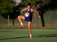 KASHIMA, JAPAN - AUGUST 1: Carli Lloyd #10 of the USWNT controls the ball during a training session at the practice field on August 1, 2021 in Kashima, Japan.