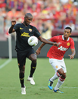 FC Barcelona defender Eric Abidal (22) shields the ball against Manchester United midfielder Nani (17) Manchester United defeated Barcelona FC 2-1 at FedEx Field in Landover, MD Saturday July 30, 2011.