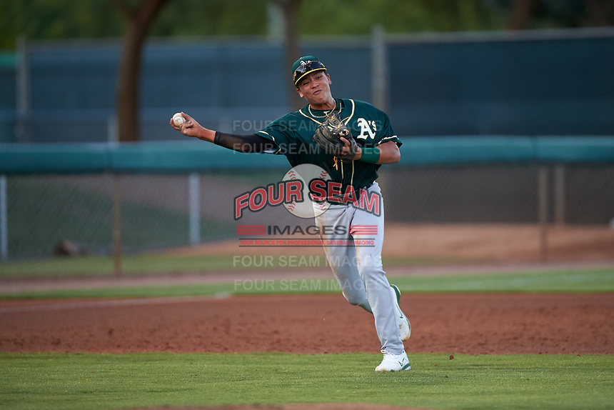AZL Athletics Green third baseman Dustin Harris (15) throws to first base during an Arizona League game against the AZL Dodgers Lasorda at Camelback Ranch on June 19, 2019 in Glendale, Arizona. AZL Dodgers Lasorda defeated AZL Athletics Green 9-5. (Zachary Lucy/Four Seam Images)