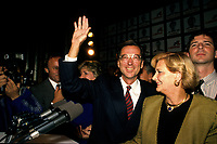 Montreal (QC)CANADA - September 25, 1989  File Photo<br /> Quebec Premier and<br /> Liberal Provincial Leader Robert Bourassa wave at photographer after winning on election day.<br /> Beside him are his wife and son Francois.