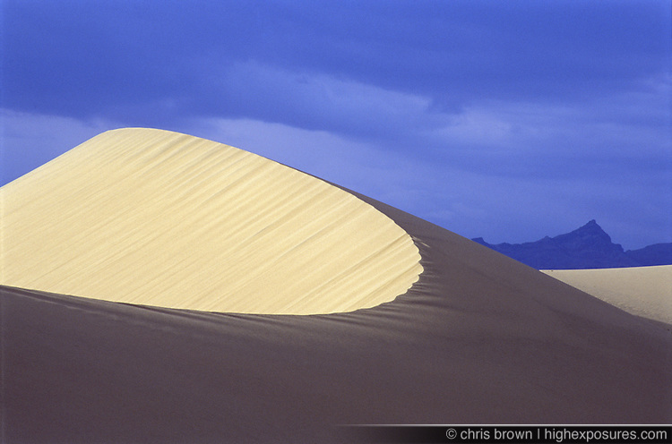 Cloudy skies above the giant white sand dunes in Death Valley's Eureka Dunes.