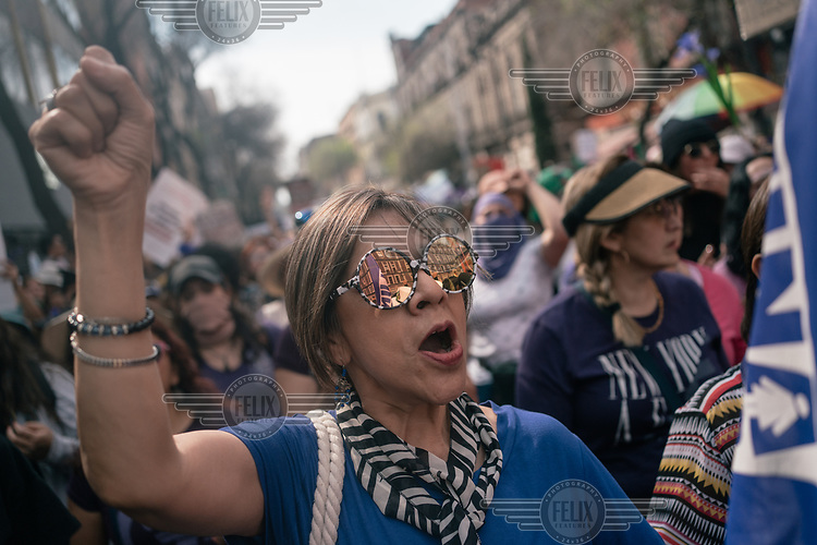 A woman shouts slogans during a protest on International Women's Day. The annual demonstrationintensified and turned into a bigger movementagainst gender-based violenceamid an increase in killings of women and girls.