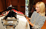 Laurann Claridge browsws at a cocktail party at the home of Becca Cason Thrash featuring a trunk show from Christos Garkinos, owner of the L.A. boutique Decadestwo Wednesday April 21,2010.. (Dave Rossman Photo)