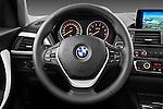 Steering wheel view of a 2011 - 2014 BMW 118d 5 Door hatchback.