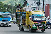 Colorfully painted delivery trucks, Dili, Timor-Leste (East Timor). Owners of taxis, trucks, and other vehicles give them names and often elaborate paint jobs to attract customers.