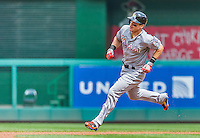 30 August 2015: Miami Marlins outfielder Derek Dietrich rounds the bases after hitting a solo home run to lead off the 4th inning against the Washington Nationals at Nationals Park in Washington, DC. The Nationals rallied to defeat the Marlins 7-4 in the third game of their 3-game weekend series. Mandatory Credit: Ed Wolfstein Photo *** RAW (NEF) Image File Available ***