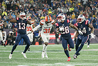 FOXBOROUGH, MA - OCTOBER 27: New England Patriots Runningback James White #28 turns as Cleveland Browns Safety Juston Burris #31 comes in for a tackle during a game between Cleveland Browns and New Enlgand Patriots at Gillettes on October 27, 2019 in Foxborough, Massachusetts.