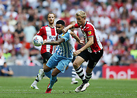 28th May 2018, Wembley Stadium, London, England;  EFL League 2 football, playoff final, Coventry City versus Exeter City; Jordan Willis of Coventry City puts pressure on Jayden Stockley of Exeter City