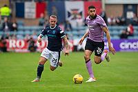 25th September 2021; Kilmac Stadium, Dundee, Scotland: Scottish Premiership football, Dundee versus Rangers; Leigh Griffiths of Dundee beaten by Leon Balogun of Rangers