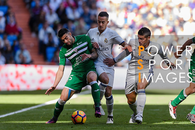 Diego Rico of Deportivo Leganes competes for the ball with Lucas Vazquez and James Rodriguez of Real Madrid during their La Liga match between Real Madrid and Deportivo Leganes at the Estadio Santiago Bernabéu on 06 November 2016 in Madrid, Spain. Photo by Diego Gonzalez Souto / Power Sport Images