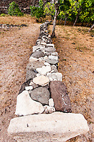 Restored ancient Hawaiian stone wall in  Nualolo Kai village, Na Pali Coast, Kaua'i