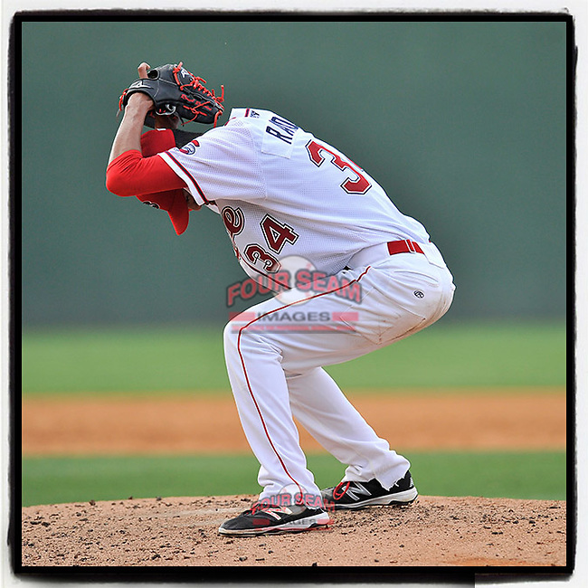#OTD On This Day, June 26, 2016, starting pitcher Roniel Raudes (34) of the Greenville Drive goes through a most unusual delivery as he winds up before delivering a pitch in a game against the Lakewood BlueClaws at Fluor Field at the West End in Greenville, South Carolina. Raudes earned the win, 2-1. He has pitched in the minors and for the Nicaraguan national team. In 2016 he was a mid-season All-Star in the South Atlantic League. He did not play in 2019 due to injuries. (Tom Priddy/Four Seam Images) #MiLB #OnThisDay #MissingBaseball #nobaseball #stayathome #minorleagues #minorleaguebaseball #Baseball #SallyLeague #AloneTogether