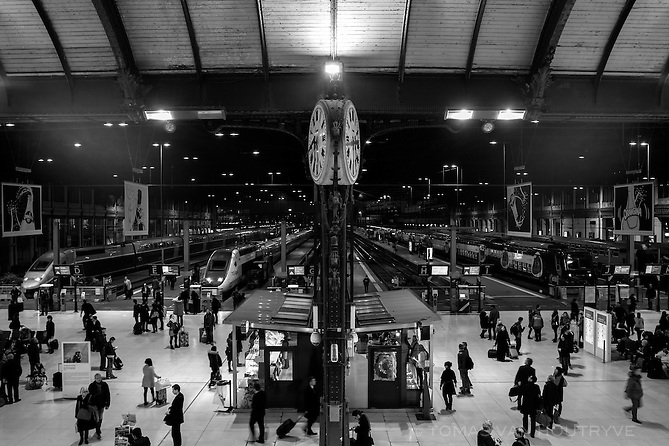 Travelers and commuters are seen in the Gare de Lyon train station in Paris, France three days after coordinated terrorist attacks struck the heart of the French capital. Most trains were fully operational and packed with commuters on the first Monday after the attack.