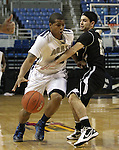 Agassi Prep's Kalinn Jackson pushes pasat West Wendover's Avery Arrien during the NIAA 2A State Basketball Championship game between West Wendover and Agassi Prep high schools at Lawlor Events Center, in Reno, Nev, on Saturday, Feb. 25, 2012. .Photo by Cathleen Allison