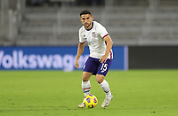 ORLANDO CITY, FL - JANUARY 31: Cristian Roldan #15 of the United States turns and moves with the ball during a game between Trinidad and Tobago and USMNT at Exploria stadium on January 31, 2021 in Orlando City, Florida.