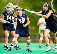 1 May 2010: University of New Hampshire Wildcat midfielder Amber Casiano, a Freshman from South Windsor, CT, gets to the ball as teammate attacker JoJo Curro, a Sophomore from Amherst, NH, looks on during game action against the University of Vermont Catamounts at Moulton Winder Field in Burlington, Vermont. The visiting Wildcats defeated the Lady Catamounts 18-10 in the last game of the 2010 regular season. Mandatory Photo Credit: Ed Wolfstein Photo
