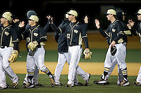 The Wake Forest Demon Deacons celebrate their season opening win over the Delaware Blue Hens at Wake Forest Baseball Park on February 13, 2015 in Winston-Salem, North Carolina.  The Demon Deacons defeated the Blue Hens 3-2.  (Brian Westerholt/Four Seam Images)