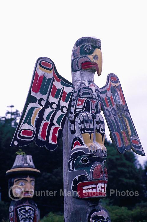Kwakwaka'wakw (Kwakiutl) Memorial Totem Poles, on Namgis Burial Grounds, Alert Bay, Cormorant Island, BC, British Columbia, Canada - Thunderbird sits atop Grizzly Bear in foreground