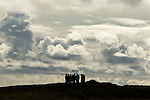 A film crew pauses during recording on a hill in Iceland. The film crew was filming the Cape Farewell Youth Expedition organized by the British Council of Canada.
