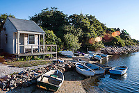 Rustic rowboats and shack , Taylors Pond, Cape Cod, Massachusetts, USA.