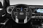 Car pictures of steering wheel view of a 2017 Toyota Tacoma TRD Sport 4 Door Pick Up Steering Wheel