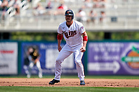 Minnesota Twins Josh Donaldson (20) leads off first base during a Major League Spring Training game against the Pittsburgh Pirates on March 16, 2021 at Hammond Stadium in Fort Myers, Florida.  (Mike Janes/Four Seam Images)