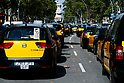 Taxi drivers in Barcelona protest against ride-hailing apps such as Uber and Cabify