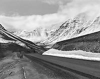 """""""Dalton Highway Through Atigun Pass""""<br /> The Brooks Range, Alaska <br /> <br /> The Dalton Highway travels through the Brooks Mountains north of the Arctic Circle in Alaska. The Brooks are a beautiful but intimidating mountain range. This black and white image shows the Dalton Highway at Atigun Pass in the Brooks mountains."""