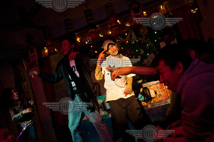 Young Bhutanese teenagers dance to the Latino and Bollywood tunes at the New Lee Drayang and Throkhang in Thimphu, Bhutan.