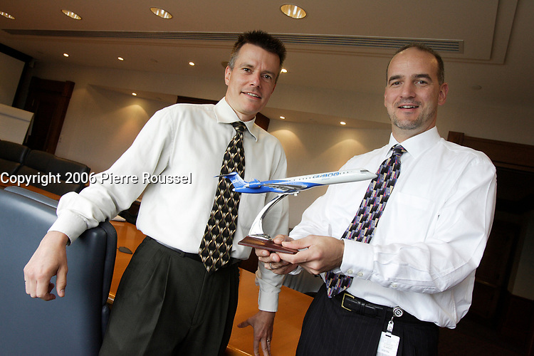 Benjamin Boehm, Director Program Management Office NEW COMMERCIAL AIRCRAFT PROGRAM (Left) and Michael R. McAdoo, V-P Startegy and Business Development AEROSPACE (Bombardier) (Right)<br /> hold a model of CRJ 800, Bombardier biggest plane so far.