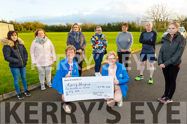 The residents of Casements View present a cheque for €1,150 to the Kerry Hospice from their recent Coffee Morning fundraiser. Front: Maura O'Sullivan and Margaret Crean from the Kerry Hospice. Back l to r: Sonya Hanafin, Mary Lyon, Noreen and Michelle Walsh, Brenda O'Connor, Ted Moynihan and Nicole O'Connor.