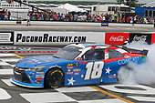 #18: Kyle Busch, Joe Gibbs Racing, Toyota Camry Comcast Salute to Service Juniper celebrates his win with a burnout