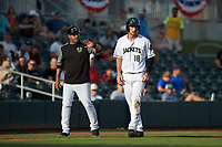 Augusta GreenJackets manager Carlos Valderrama (21) gives instructions to Jacob Gonzalez (18) during the game against the Kannapolis Intimidators at SRG Park on July 6, 2019 in North Augusta, South Carolina. The Intimidators defeated the GreenJackets 9-5. (Brian Westerholt/Four Seam Images)