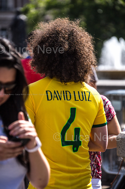 """London, 12/06/2014. Today, on the day of the opening ceremony of the 20th World Cup of Football in Sao Paolo (Brasil), a group of Brasilian people held a demonstration in Trafalgar Square to raise awareness of the problems that are still affecting their country (see photo captions) and in support and solidarity with the protests currently happening in Brasil. Meanwhile, the official """"Brazil Day"""" organised by the Mayor of London was held without disruption in the main square."""