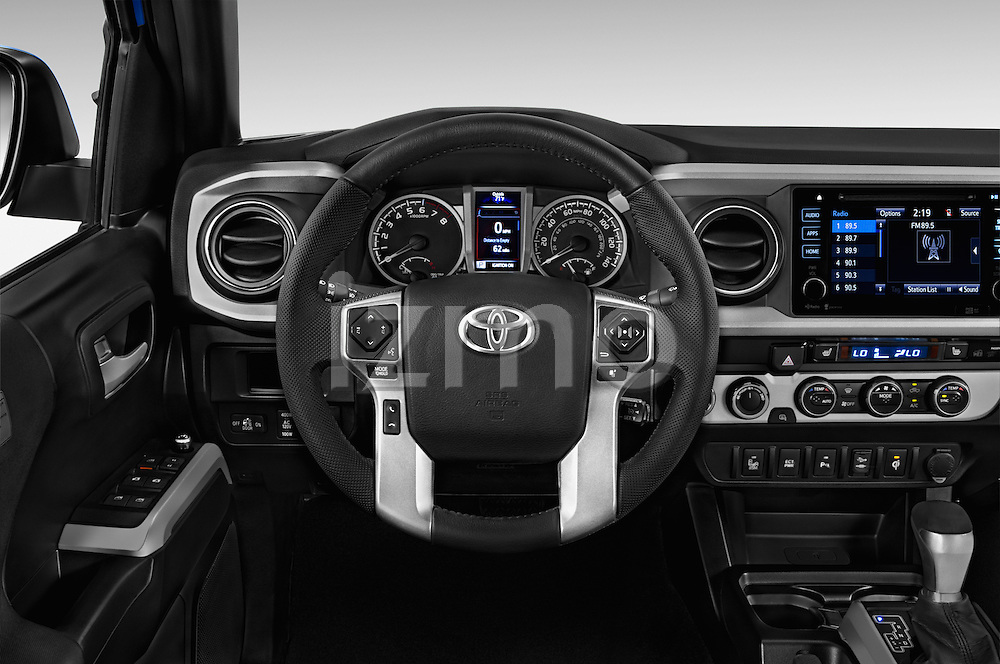 Car pictures of steering wheel view of a 2016 Toyota Tacoma TRD Sport 4 Door Pickup Steering Wheel