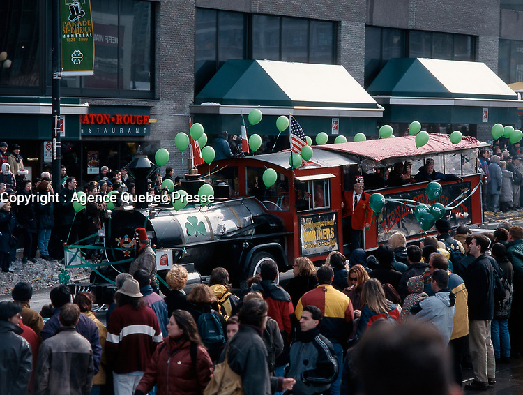 Montreal (Qc) CANADA - March 14 1993 File Photo -<br /> Saint-Patrick Day Parade on Sainte-Catherine street in downtown Montreal.