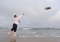 Business man, throwing briefcase into the ocean, Stone Harbor, New Jersey