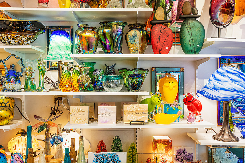 Decorative fine art glass products for sale in glass shop.