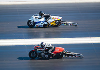 Nov 3, 2019; Las Vegas, NV, USA; NHRA pro stock motorcycle rider Eddie Krawiec (near) against Kelly Clontz during the Dodge Nationals at The Strip at Las Vegas Motor Speedway. Mandatory Credit: Mark J. Rebilas-USA TODAY Sports