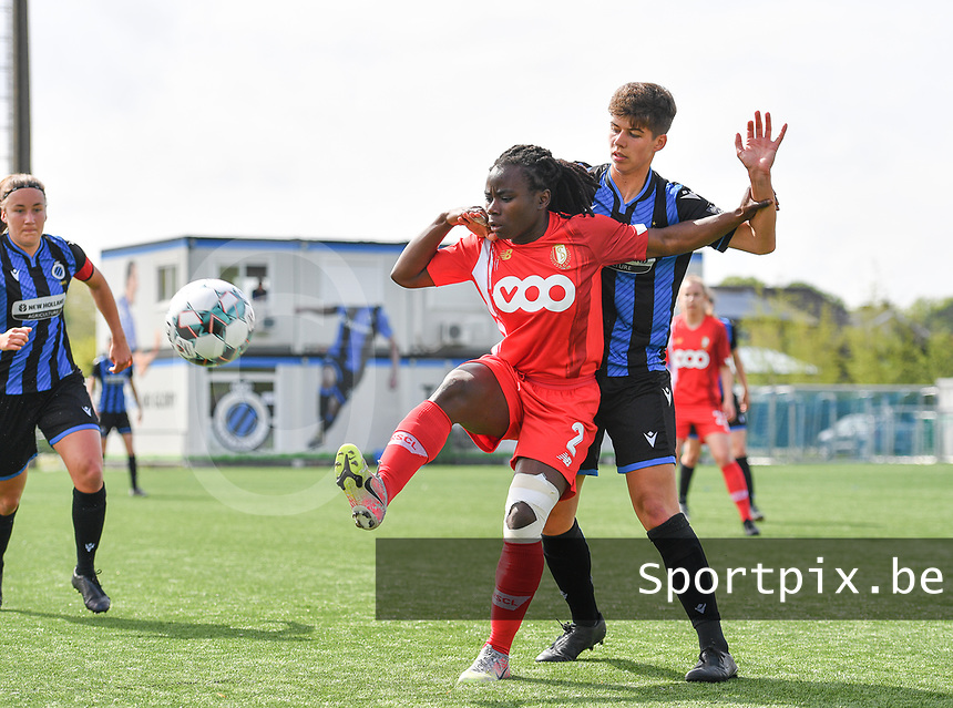 Fon Welma (2) of Standard  pictured in a duel with Isabelle Iliano (18) of Club Brugge during a female soccer game between Club Brugge Dames YLA and Standard Femine de Liege on the seventh matchday in Play-Off 1 of the 2020 - 2021 season of Belgian Scooore Womens Super League , saturday 15 May 2021  in Brugge , Belgium . PHOTO SPORTPIX.BE | SPP | DAVID CATRY